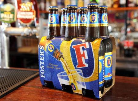 Bottles of Foster's beer sits on the bar at the Drop Bear Inn in South Melbourne on November 25, 2011.  Australia's government approved brewer SABMiller's Aus$9.9 billion (US$9.62 billion) takeover of Foster's, but with strict conditions that will see key operations remain in the country.  Treasurer Wayne Swan said the deal was in the national interest and given Foster's iconic status in Australia, he set certain conditions on the sale which would put the brand in foreign hands for the first time in its 150-year history.  AFP PHOTO / WILLIAM WEST (Photo credit should read WILLIAM WEST/AFP/Getty Images)