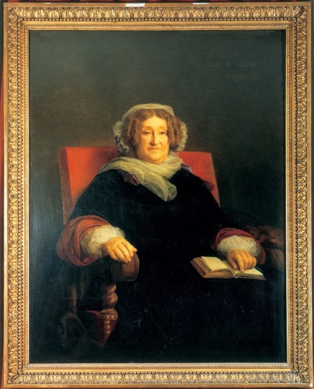 Portrait de Madame Clicquot par Léon Cogniet (1794-1880). Huile sur toile (129,5 cm X99,3 cm), peinte entre 1851 et 1861. Ce tableau a été commandé par Madame Clicquot à l'artiste. Il s'en dégage une autorité évidente, la couleur cramoisie du fauteuil ajoute à la force de l'ensemble. L'original appartient à la Maison Veuve Clicquot. Libre de droits hors publicité avec achat d'espace. Mention obligatoire : «Veuve Clicquot». A portrait of Madame Clicquot by Léon Cogniet (1794-1880). Oil on convas (129.5 cm x 99.3cm), painted between 1851 and 1861. This work was commissioned by Madame Clicquot. She is portrayed with a definite air of authority, underlined by the crimson colour of the chair in which she is seated. The painting belongs to Veuve Clicquot. Free of all copyrights, except advertising with media buying. Photo credit: «Veuve Clicquot».