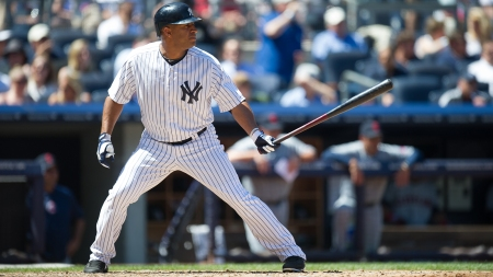 NEW YORK - JUNE 05:  Vernon Wells #12 of the New York Yankees bats during the game against the Cleveland Indians at Yankee Stadium on June 5, 2013 in the Bronx borough of New York City. (Photo by Rob Tringali)