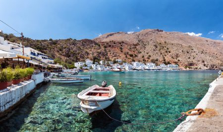 Small motorboat at clear water bay of Loutro town on Crete island, Greece