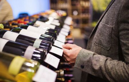 14-man_picking_out_wine-franklin_liquors